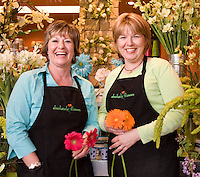 "Absolutely Flowers owners Karen Maness (left) and Mitzi Alexander laugh and enjoy their day at their floral shop in Hutchinson, KS.  Wholesale Florist & Florist Supplier Association (WF&FSA), selected Absolutely Flowers as the winner of the ""Outstanding Merchandising and Display"" category."