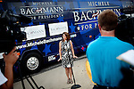Republican presidential candidate, Rep. Michele Bachmann speaks to reporters at a campaign stop held at a Pizza Ranch in Newton, Iowa, August 5, 2011.