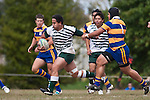 Matt Talese makes a strong run past Patumahoe captain Siosiua Pole. Counties Manukau Premier Club Rugby game between Manurewa and Patumahoe played at Mountfort Park Manurewa on Saturday 3rd April 2010..Patumahoe won 26 - 8 after leading 14 - 3 at halftime.