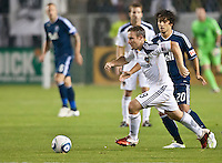 CARSON, CA - September 17, 2011: LA Galaxy midfielder Chris Birchall (8) and Vancouver Whitecaps forward Davide Chiumiento (20) during the match between LA Galaxy and Vancouver Whitecaps at the Home Depot Center in Carson, California. Final score LA Galaxy 3, Vancouver Whitecaps 0.