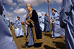 Grand Bard wearing crown having just been appointed. Cornish Bards dressed in blue at the annually for  Gorseth Ceremony Marazion Cornwall UK Gorseth Kernow (Cornish Gorsedd) which is a non-political Cornish organisation, which exists to maintain the national Celtic spirit of Cornwall in Britain. The Gorseth Kernow supports the revival of the Cornish language, encourages the study of the arts and history and everything Cornish.  Bardships are awarded for momentous works on Cornish culture.