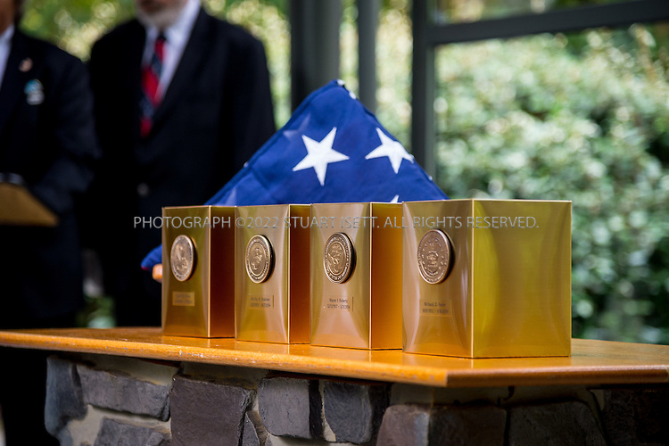 9/30/2016-- Tahoma National Cemetery, Kent, WA, USA<br /> <br /> Here: the remains of (left to right) Russell Ristow, Rocky Stallone, Wayne Roberts &amp; Richard Fesler placed in a commitment shelter during funerals services at the Tahoma National Cemetery.<br /> <br /> James Lindley, 34, an undertaker and US Marine Corp Veteran, works at the Columbia Funeral Home in Seattle, Washington and has taken it upon himself to process the remains of indigent veterans and ensure their remains are placed in Tahoma National Cemetery in nearby Kent, WASH. The veterans are given full military funerals with active service members as well as volunteers who stand-in for unavailable next-of-kin, accepting the folded flags provided by the Veterans Administration.<br /> <br /> On this day, with the help of Mr. Lindley, the remains of 4 veterans were interred at the Tahoma National Cemetery: <br /> <br /> Richard Fesler, born 1951, died 2014. US Army Veteran<br /> Rocky Stallone, born 1951, died 2014. Marine Corps veteran<br /> Russell Ristow, born 1944, died 2014. US Army veteran.<br /> Wayne Roberts, Born 1937, died 2014. US Navy veteran.<br /> <br /> <br /> Credit: Stuart Isett for The Wall Street Journal. <br /> VETBODIES<br /> <br /> &copy;2016 Stuart Isett. All rights reserved.