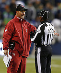 Arizona Cardinals Head Coach Ken Whisenhunt argues a call with Line Judge Tom Symonette during a game against the Seattle Seahawks at CenturyLink Field in Seattle, Washington on  December 9, 2012.  The Seahawks beat the Cardinals 58-0.  ©2012. Jim Bryant Photo. All Rights Reserved.