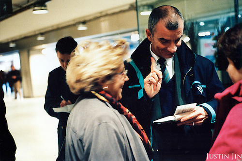 A controller catches a middle-aged woman for not having a ticket in Paris metro..Picture taken 2005 by Justin Jin