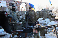 Ukrainian soldiers stand on guard at the check-point near Luhanskoe Village. Eastern Ukraine. 24 February 2015