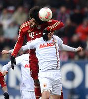 FUSSBALL   1. BUNDESLIGA  SAISON 2012/2013   16. Spieltag FC Augsburg - FC Bayern Muenchen         08.12.2012 Dante (li, FC Bayern Muenchen) gegen Jan Ingwer Callsen Bracker (FC Augsburg)