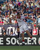 New England Revolution midfielder Kelyn Rowe (11) and DC United defender Chris Korb (22) battle for head ball. In a Major League Soccer (MLS) match, DC United defeated the New England Revolution, 2-1, at Gillette Stadium on April 14, 2012.