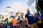 SACRAMENTO, CA - NOVEMBER 22:  Ken Brendel, center, and Dana Edgar, right, march in support of gay marriage on the steps of the State Capitol in Sacramento, California November 22, 2008. People across the country continue to protest the passing of California State Proposition 8 which makes gay marriage in California illegal. (Photo by Max Whittaker/Getty Images)
