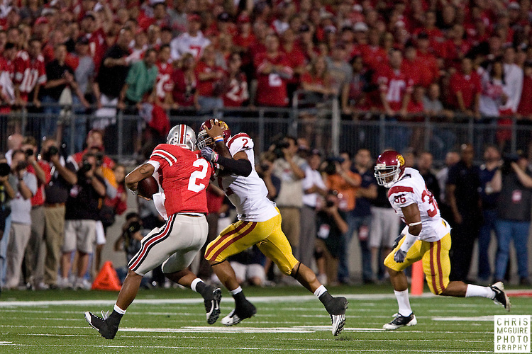 12 September 2009:  Football -- USC safety Taylor Mays runs down Ohio State quarterback Terrelle Pryor during their game at Ohio Stadium in Columbus.  USC won 18-15.  Photo by Christopher McGuire.