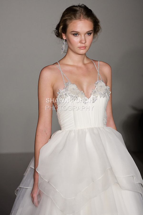 Model walks runway in a Hattie wedding dress - ivory crystal Georgette ballet bodice ball gown with a manipulated Georgette, organza and tulle skirt, by Hayley Paige, for the Hayley Paige Spring 2012 Bridal collection, at the JLM Couture fashion show, during Bridal Week New York Spring 2012.