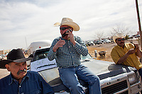 Cattle workers hang out in Columbus, New Mexico. Recently federal authorities arrested the mayor, police chief, and trustees who were allegedly operating an illegal gun running ring. ..INFO: MAN ON LEFT CANNOT BE IDENTIFIED (Chad Shannon, center, and Juan Chavira, right)