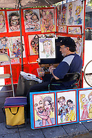 Sidewalk artist selling his carictures in Old Montreal, Quebec, Canada
