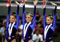30 SEPTEMBER 1999 - OSAKA, JAPAN: (L-R) ALINA KABAEVA, YULIA BARSOUKOVA, OLGA BELOVA of Russia celebrate team gold at 1999 World Championships in Osaka, Japan. Just out of the frame is Irina Tchachina, 2004 Athens Olympic silver medalist.