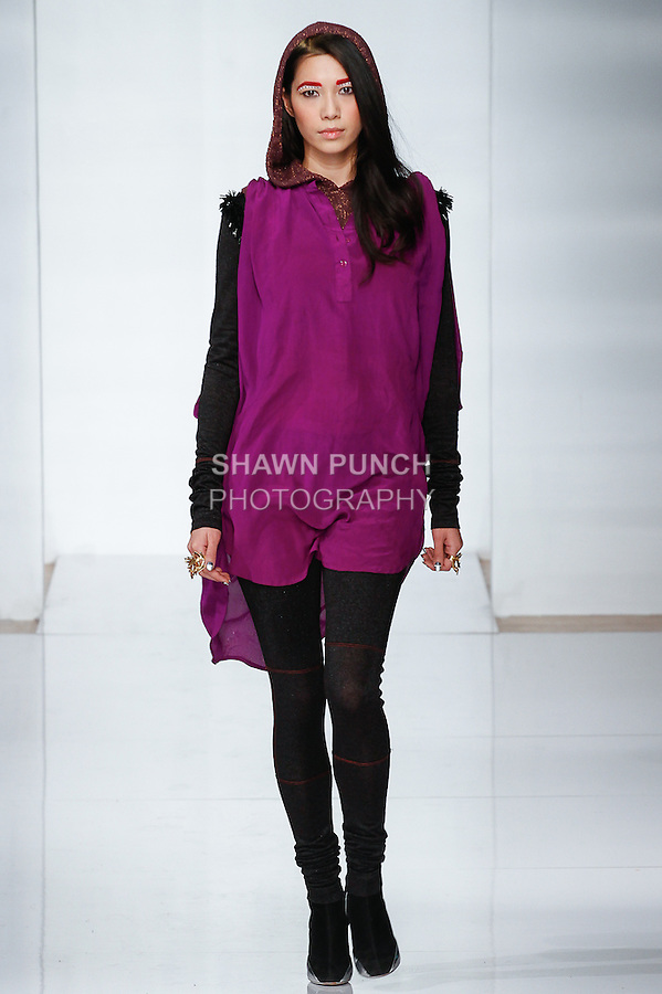 Model walks runway in an outfit from the Abacaxi Fall Winter 2014 collection by Sheena Sood, at the Launch NYC Manufacture New York Incubator Runway Show, during New York Fashion Week on February 5, 2014.