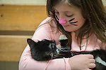 Wantagh, New York, USA. February 5, 2017.  AYLA SHAH, 6 1/2, of Merrick, is holding SALSA, a 5 month old female kitten available for adoption at Last Hope Animal Rescue's Open House party during Hallmark Channel's Kitten Bowl IV. Kittens in its Last Hope Lions team played against kittens in North Shore Bengals team. Last Hope kittens have been part of each Kitten Bowl, whose purpose is to promote cat and kitten adoptions.