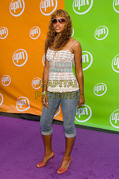 EVE.UPN Summer Press Tour Party .Paramount Studios.Los Angeles, 21st July 2005.full length full-length sunglasses gold necklace bracelet curly hair paw tattoo white pattern drawstring top short jeans red t-bar shoes.www.capitalpictures.com.sales@capitalpictures.com.© Capital Pictures.