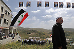 Druze Sheikhs and residents hold a pro-Syrian demonstration on the Syrian independence day in front of Syria's soil (in background), in Majdal Shams, Golan Heights, close to Israel-Syria border.