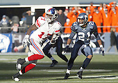 27 Nov 2005:   New York Giants wide receiver Plaxico Burress tries to get free from Seattle Seahawks corner back Andre Dyson at Qwest Field in Seattle, Washington.