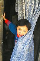 Tibetan girl, Tenzin Khando at home.