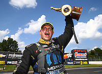 Sep 5, 2016; Clermont, IN, USA; NHRA funny car driver Matt Hagan celebrates after winning the US Nationals at Lucas Oil Raceway. Mandatory Credit: Mark J. Rebilas-USA TODAY Sports
