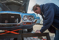 NWA Democrat-Gazette/ANTHONY REYES @NWATONYR<br /> Jack Davis secures a 1972 Ford Gran Torino Friday, Feb. 10, 2017 onto a trailer near his shop in downtown Bentonville. Tapin plans on trading the Torino for a 1946 Chrysler New Yorker.