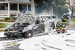 MANASQUAN, NJ — April 1, 2016 —Manasquan firefighters use foam to battle a stubborn car fire on Broad Street at about 9:40am Friday morning. The driver of the vehicle was not injured.  photo by Andrew Mills