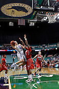 Tricia Liston tries to jump over Wolfpack defense. NC State defeated Duke 75-73 during quarter finals of the 2012 ACC Women's Basketball Tournament at the Greensboro Coliseum in Greensboro, NC. Photo by Al Drago.