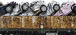Damaged vehicles are loaded onto a truck near Minamisanriku,  Miyagi Prefecture on Feb. 25, 2012. .Photographer: Robert Gilhooly