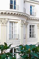 This classic 19th century Parisian apartment building has Corinthian pilasters and ornate plasterwork