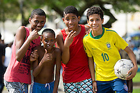 A group of kids with a football in Salvador
