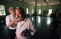 Former Italian internees Alfredo Cipolato, left, and Umberto Benedetti walk through the barracks at Ft. Missoula where Cipolato slept as an Italian internee during WWII. Benedetti's barracks was nearby. Both men have stayed in the Missoula, Mont. area.