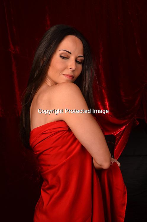 Seductive Hispanic Woman Stock Photo