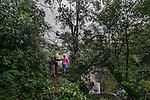 November 20, 2014.<br /> Varias mujer mayas observan la cascada del r&iacute;o Cambalan donde la empresa espa&ntilde;ola Ecoener pretende hacer una hidroel&eacute;ctrica, en Santa Cruz de Barillas (Guatemala).<br />   La llegada de algunas compa&ntilde;&iacute;as extranjeras a Am&eacute;rica Latina ha provocado abusos a los derechos de las poblaciones ind&iacute;genas y represi&oacute;n a su defensa del medio ambiente. En Santa Cruz de Barillas, Guatemala, el proyecto de la hidroel&eacute;ctrica espa&ntilde;ola Ecoener ha desatado cr&iacute;menes, violentos disturbios, la declaraci&oacute;n del estado de sitio por parte del ej&eacute;rcito y la encarcelaci&oacute;n de una decena de activistas contrarios a los planes de la empresa. Un grupo de ind&iacute;genas mayas, en su mayor&iacute;a mujeres, mantiene cortado un camino y ha instalado un campamento de resistencia para que las m&aacute;quinas de la empresa no puedan entrar a trabajar. La persecuci&oacute;n ha provocado adem&aacute;s que algunos ecologistas, con &oacute;rdenes de busca y captura, hayan tenido que esconderse durante meses en la selva guatemalteca.<br /> <br /> En Cob&aacute;n, tambi&eacute;n en Guatemala, la hidroel&eacute;ctrica Renace se ha instalado con amenazas a la poblaci&oacute;n y falsas promesas de desarrollo para la zona. Como en Santa Cruz de Barillas, el proyecto ha dividido y provocado enfrentamientos entre la poblaci&oacute;n. La empresa ha cortado el acceso al r&iacute;o para miles de personas y no ha respetado la estrecha relaci&oacute;n de los ind&iacute;genas mayas con la naturaleza. &copy; Calamar2/Pedro ARMESTRE<br /> <br /> The arrival of some foreign companies to Latin America has provoked abuses of the rights of indigenous peoples and repression of their defense of the environment. In Santa Cruz de Barillas, Guatemala, the project of the Spanish hydroelectric Ecoener has caused murders, violent riots, the declaration of a state of siege by the army and the imprisonment of a doz