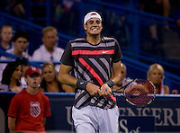 John Isner shows his frustration during the Legg Mason Tennis Classic at the William H.G. FitzGerald Tennis Center in Washington, DC.  Unseeded Xavier Malisse defeated American John Isner in three sets in a thunderstorm delayed evening session.