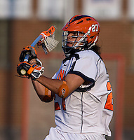 Ken Clausen (27) takes  a stick-bending shot during the ACC men's lacrosse tournament semifinals in College Park, MD.  Virginia defeated Duke, 16-12.