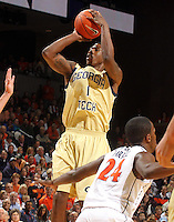 Jan. 22, 2011; Charlottesville, VA, USA; Georgia Tech Yellow Jackets guard Iman Shumpert (1) shoots over Virginia Cavaliers guard K.T. Harrell (24) during the game at the John Paul Jones Arena. Mandatory Credit: Andrew Shurtleff-US PRESSWIRE