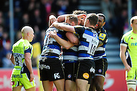 Ollie Devoto of Bath Rugby is congratulated on his try by team-mates. Aviva Premiership match, between Bath Rugby and Sale Sharks on April 23, 2016 at the Recreation Ground in Bath, England. Photo by: Patrick Khachfe / Onside Images