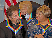 Al Pacino, left, one of the five recipients of the 39th Annual Kennedy Center Honors, gospel and blues singer Mavis Staples, right, and Joe Walsh of the rock band &quot;The Eagles,&quot; center, share some words as they prepare to pose for a group photo following a dinner hosted by United States Secretary of State John F. Kerry in their honor at the U.S. Department of State in Washington, D.C. on Saturday, December 3, 2016.  The 2016 honorees are: Argentine pianist Martha Argerich; rock band the Eagles; screen and stage actor Al Pacino; gospel and blues singer Mavis Staples; and musician James Taylor.<br /> Credit: Ron Sachs / Pool via CNP