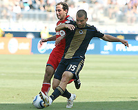 Alejandro Moreno #15 of the Philadelphia Union knocks the ball away from Nick LaBrocca #21 of Toronto FC during an MLS match at PPL stadium in Chester, PA. on July 17 2010. Union won 2-1 with a last minute penalty kick goal.