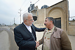 Father Emanuel Youkhana (left) talks with an Iraqi army commander outside the ruins of a Syriac Orthodox Church in Mosul, Iraq, on January 27, 2017. According to neighbors, the Islamic State group--which took over the city in 2014--used the building as a warehouse until the final weeks of their occupation, when they awarded the building to a contractor who began to demolish it in order to salvage the steel rebar in the walls. Although this portion of the city was liberated by the Iraqi army  in early 2017, Christians are unlikely to return soon due to concerns about their security in the Sunni community.<br /> <br /> Youkhana is a priest in Duhok of the Holy Apostolic Catholic Assyrian Church of the East.