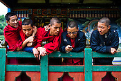 Buddhist monks play with a mobile phone outside the Ramtanka Temple in Paro, Bhutan. Photo: Sanjit Das/Panos