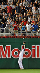 10 July 2008: Washington Nationals' left fielder Wily Mo Pena pulls in a fly ball during game action against the Arizona Diamondbacks at Nationals Park in Washington, DC. The Diamondbacks defeated the Nationals 7-5 in 11 innings to take the rubber match of their 3-game series in the Nation's Capitol...Mandatory Photo Credit: Ed Wolfstein Photo