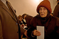 Kiev, Ukraine, 26/12/2004..The third and final round of Ukraine's disputed Presidential election.An election officer helps a pensioner to the ballot box at a polling station.