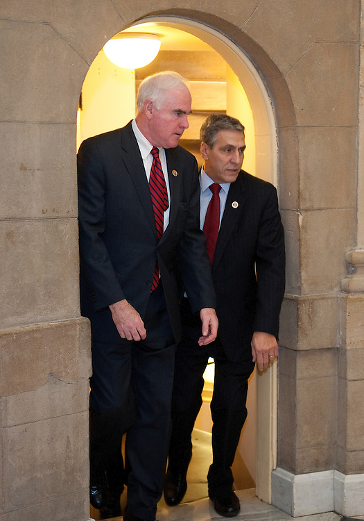UNITED STATES - Jan 4: Rep. Patrick Meehan, R-PA., and Rep. Lou Barletta, R-PA., leave the GOP caucus and try to squeeze through a small door leading to the Speakers Office at the same time in the U.S. Capitol on January 4, 2013.  (Photo By Douglas Graham/CQ Roll Call)