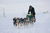 Musher Jeff King races along the coast of Nome, near the checkpoint of Safety, during the 2008 All Alaska Sweepstakes sled dog race.
