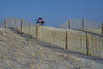 Children play tag atop a sand dune in Chincoteague, VA