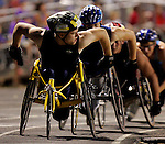 Jordan Bird #230 leads the pack in the boys 5000 meter race held after opening ceremonies of the Junior Wheelchair Championships in Mesa, AZ.