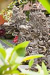 Ubud, Bali, Indonesia; stone dragons line stairs inside the Balinese Hindu temple, Pura Taman Saraswati