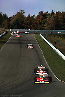WATKINS GLEN, NY - OCTOBER 5: Niki Lauda #12 Ferrari 312T 023/Ferrari 015 leads Emerson Fittipaldi #1 McLaren M23 8-2/Ford Cosworth and the rest of the field in the United States Grand Prix on October 5, 1975, at the Watkins Glen Grand Prix Race Course near Watkins Glen, New York.