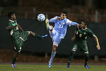 21 November 2013: North Carolina's Raby George (SWE) (33) is defended by USF's Lindo Mfeka (RSA) (12) and Stiven Salinas (COL) (9). The University of North Carolina Tar Heels hosted the University of South Florida Bulls at Fetzer Field in Chapel Hill, NC in a 2013 NCAA Division I Men's Soccer Tournament First Round match. North Carolina won the game 1-0.